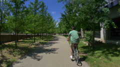 4K Man Rides Bike in Pittsburgh - stock footage