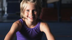 CU Portrait of girl (8-9) wearing leotard in gym, Orem, Utah, USA Stock Footage