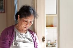 A 50s asian woman at home taking rest Stock Photos