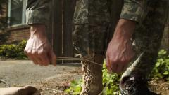 Tying Boots Stock Footage