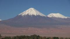 Atacama Licancabur Volcano with snow on summit Stock Footage