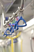 Handles for standing passenger inside a train - stock photo