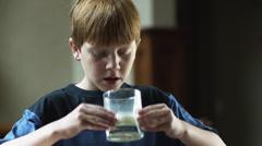 CU Boy (10-11) drinking milk at table, American Fork, Utah, USA Stock Footage