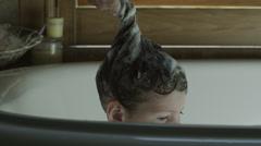 CU TU Girl (2-3) washing hair in bathtub, American Fork, Utah, USA Stock Footage
