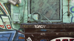 MS Homeless man exiting garbage container, Salt Lake City, Utah, USA Stock Footage