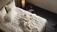 WS HA Young woman lying on bed, Salt Lake City, Utah, USA Stock Footage