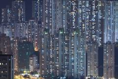 """Hong Kong crowded apartments at night - The feeling of """"Under th Stock Photos"""