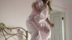 MS Girl (2-3) jumping on bed, American Fork, Utah, USA Stock Footage