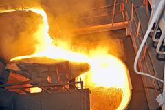 Pouring molten steel Stock Photos