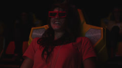 MS Young woman in 3-D movie theater, Provo, Utah, USA Stock Footage