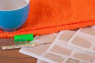 Stock Photo of mustard plaster with towel and cup