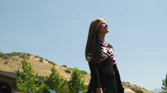 SLO MO MS LA Two teenage (16-17) cheerleaders performing outdoors, American Stock Footage