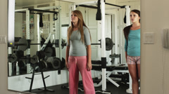 WS Two teenage (16-17) girls exercising in health club, American Fork, Utah, USA Stock Footage
