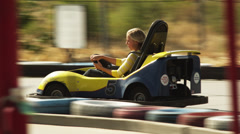 WS TS Young woman riding go-cart, Orem, Utah, USA Stock Footage