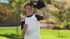 MS Baseball player (12-13) catching ball, American Fork, Utah, USA Stock Footage
