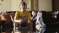 MS Two boys (12-13) playing computer game, American Fork, Utah, USA - stock footage