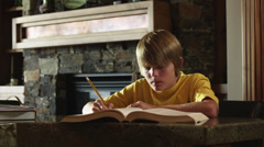 MS DS Boy (12-13) doing homework, American Fork, Utah, USA Stock Footage