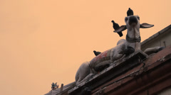 Cow statue as religious symbol at hindu temple in Singapore Stock Footage