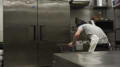 MS SHAKY Man cleaning steel counter in commercial kitchen, Salt Lake City, Utah, Stock Footage