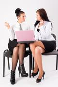 Two women work in team - stock photo