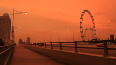 Singapore Flyer and traffic at Marina Bay in Singapore Stock Footage