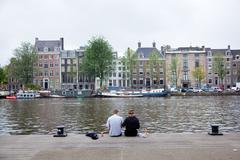 Picknick on the embankment of river amstel Stock Photos