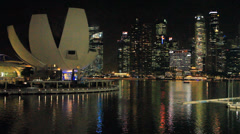 Night view of central Singapore Harbor with skyscapers and museum in Singapore Stock Footage