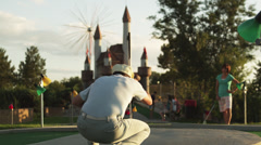 MS Man playing mini golf, suddenly running around waving hands, Orem, Utah, USA - stock footage