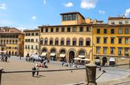 Stock Photo of tourists on a sloping square before the palace pitti. florence, italy