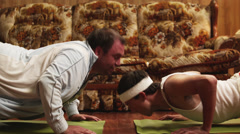 MS TU Two men doing yoga on exercise mats in living room, Orem, Utah, USA Stock Footage