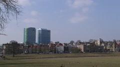 ARNHEM, THE NETHERLANDS -  city skyline + pan Sonsbeek Park Stock Footage