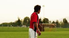 SLO MO MS LA Soccer player kicking ball on field, Orem, Utah, USA Stock Footage