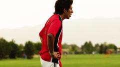 SLO MO MS PAN Soccer player kicking ball towards goal post, Orem, Utah, USA Stock Footage