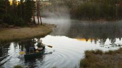 WS HA Two people rowing in kayak on lake, Uinta Mountains, Utah, USA Stock Footage