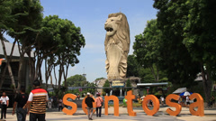 People taking photos in front of Merlion statue at Sentosa Island Stock Footage