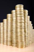 Stock Photo of Golden coins in high stacks