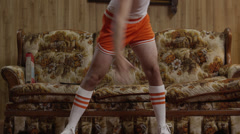 MS TU Geek man exercising in living room, Orem, Utah, USA Stock Footage