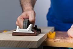 polishing wooden plank - stock photo