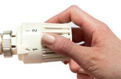 Adjusting a temperature thermostat Stock Photos