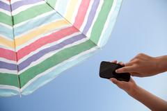 With phone on the beach - with clipping path Stock Photos