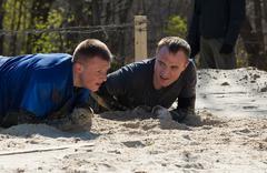Two unidentified men on sand Stock Photos