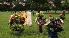 Cemetery on Memorial Day with flags and flowers Stock Footage