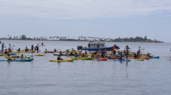 Kayaks and rowboats in boat parade 3 of 4 Stock Footage