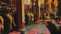 Buddhist Monks Walking in Circle During Ritual in Jade Buddha Temple, Shanghai Stock Footage