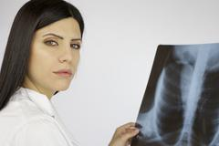 Serious worried doctor with xray Stock Photos