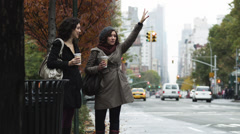 MS Two young women hailing and entering yellow cab, Manhattan, New York City, Stock Footage