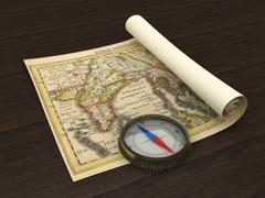 Old Map and Compass on the table - stock photo