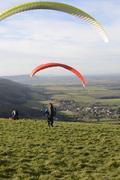 hang-gliders near brighton. england - stock photo