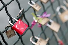 red padlock with studded heart - stock photo