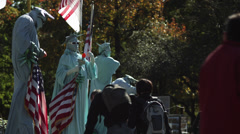 MS People in Statue of Liberty costumes in Center Park, New York City, New York, Stock Footage